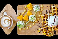 Waffles, ice cream, fresh fruit and coffee mocca. Traditional Belgian waffles with ice cream fruit and coffee mocca Stock Images