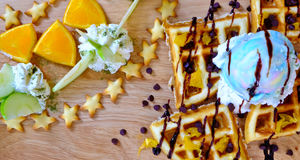 Waffles, ice cream, fresh fruit. Traditional Belgian waffles with ice cream and fruit Stock Photo