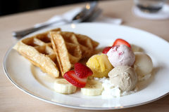 Waffles with ice cream and fruits Stock Photos