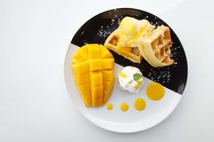 Waffles with ice cream and mango Stock Photos