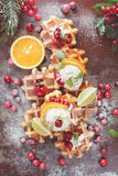 Waffles with ice cream and oranges Royalty Free Stock Images