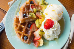 Waffles ice cream. Topping with blueberries and strawberries stock photos
