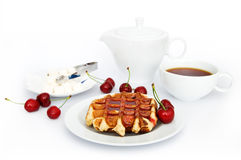 Waffles with jam. Tasty waffles with jam, tea,  teapot and cherryes over white Stock Photos