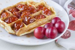 Waffles. With jam from a plum on a white plate Stock Photo