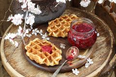 Waffles with jam. And spring bouquet Royalty Free Stock Images