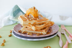Waffles a la mode. Waffles with ice cream, caramel sauce and walnuts stock image