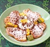 Waffles with mango fruit Royalty Free Stock Photos