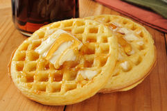 Waffles with maple syrup and butter Stock Images
