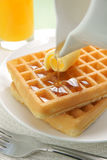 Waffles and maple syrup Stock Images