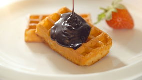Waffles with melted chocolate with strawberry stock footage