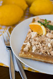 Waffles with meringue, lemon curls and orange slices Stock Image