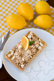 Waffles with meringue, lemon curls and orange slices Royalty Free Stock Photo