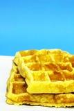 Waffles no fundo azul Imagens de Stock Royalty Free