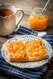Waffles with peach jam. Stock Photos
