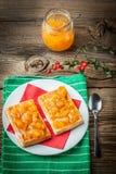 Waffles with peach jam. Royalty Free Stock Photo