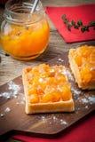 Waffles with peach jam. Stock Image