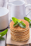 Waffles with peppermint and tea with milk. For breakfast Royalty Free Stock Photo