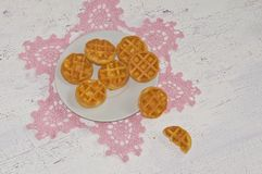 waffles on a  pink lacy napkin Stock Image