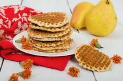 Waffles on a plate with pears and red cloth. Front view Royalty Free Stock Photos