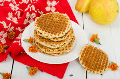 Waffles on a plate with pears and red cloth. Horizontal view Stock Photography