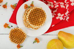 Waffles on a plate with pears and red cloth. Top view Royalty Free Stock Image
