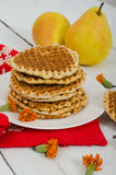 Waffles on a plate with pears and red cloth. Vertical view Stock Image