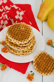 Waffles on a plate with pears and red cloth Stock Photos