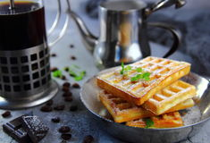 Waffles with powdered sugar and mint Royalty Free Stock Photo