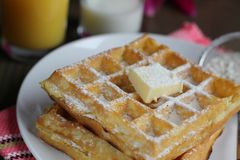 Waffles with powered sugar Stock Photo