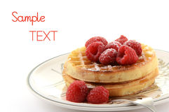 Waffles with raspberries. Waffles with fresh raspberries on white background with room for text Stock Image