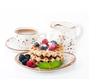 Waffles with raspberries, blueberries and cup of coffee Stock Photography