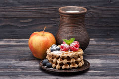 Waffles with raspberries, blueberries and milk. Healthy breakfast: waffles, berries, apples and milk Stock Image