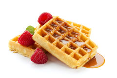 Waffles with raspberries and caramel sauce Stock Images