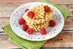 Waffles with raspberries Royalty Free Stock Photos