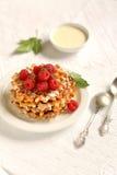 Waffles with raspberries Stock Photo