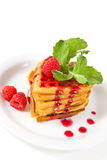 Waffles with raspberries, mint and jam. Breakfast : waffles with raspberries, mint and jam on plate Stock Photos