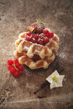 Waffles and raspberries on rustic table Royalty Free Stock Images