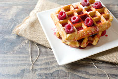 Waffles with raspberries Royalty Free Stock Images