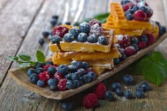 Waffles with raspberry and blueberry Stock Image