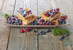 Waffles with raspberry and blueberry Royalty Free Stock Photo