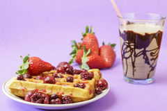 Waffles with red berries Royalty Free Stock Photo