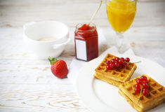 Waffles with red currant jam, orange juice and oat flakes oatmea Stock Images