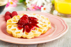 Waffles with red fruit jelly. Fresh homemade waffels with red fruit jelly and powdered sugar Royalty Free Stock Images