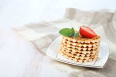 Waffles and ripe strawberries. Stock Photos