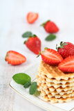 Waffles and ripe strawberries. Stock Photography