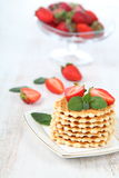 Waffles and ripe strawberries. Royalty Free Stock Photography