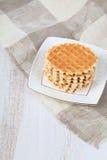 Waffles saborosos em uma placa branca Fotografia de Stock Royalty Free
