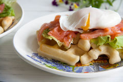 Waffles with salmon, poached egg and green salad Stock Photo