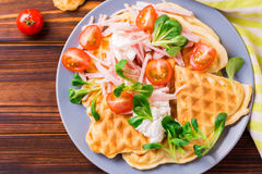 Waffles sandwich with bacon, cherry tomatoes and corn salad Stock Photos