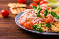 Waffles sandwich with bacon, cherry tomatoes and corn salad Stock Images